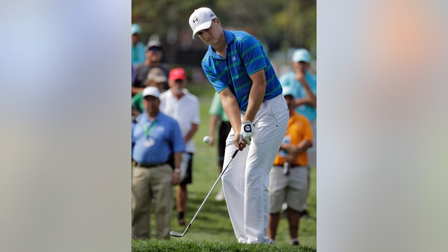 Jordan Spieth chips to the 11th green during the second round of the Valspar Championship golf tournament Friday, March 13, 2015, at Innisbrook in Palm Harbor, Fla. (AP Photo/Chris O'Meara)