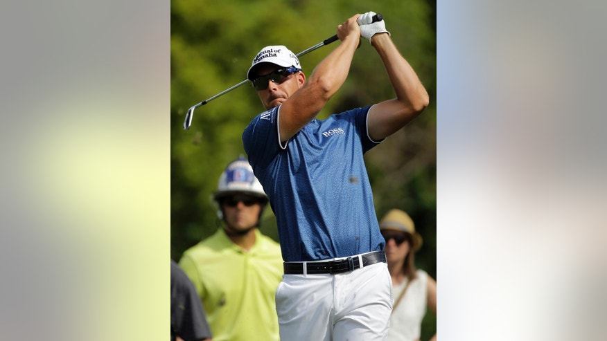 Henrik Stenson, of Sweden, hits his tee shot on the sixth hole during the second round of the Valspar Championship golf tournament Friday, March 13, 2015, at Innisbrook in Palm Harbor, Fla. (AP Photo/Chris O'Meara)