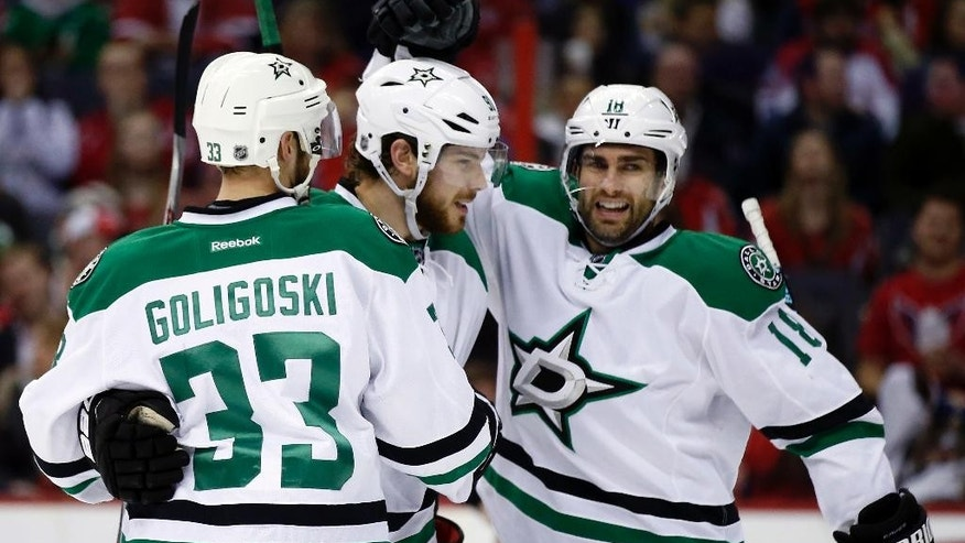 Dallas Stars defenseman Alex Goligoski (33), center Tyler Seguin (91), and right wing Patrick Eaves (18) celebrate Seguin's goal in the second period of an NHL hockey game against the Washington Capitals, Friday, March 13, 2015, in Washington. (AP Photo/Alex Brandon)