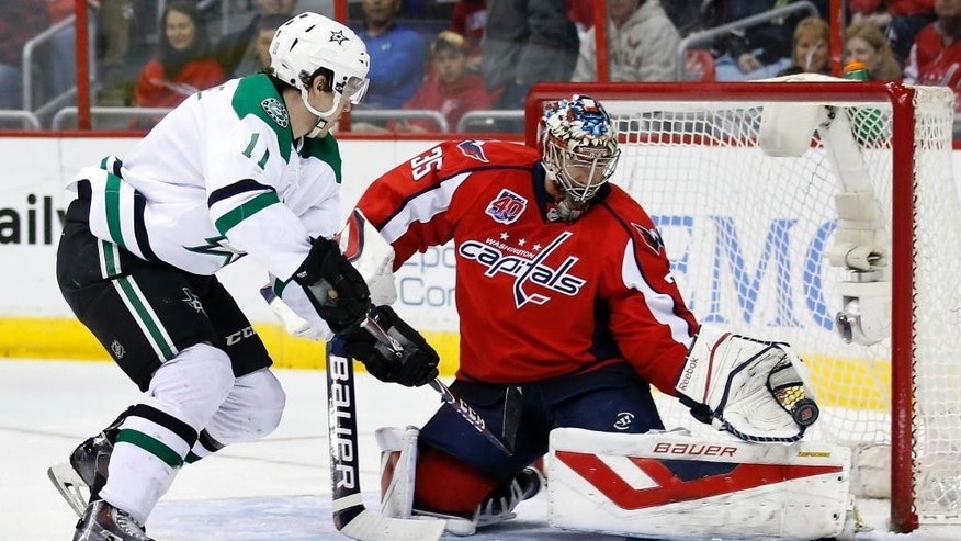 Washington Capitals goalie Justin Peters (35) makes a glove save on a shot by Dallas Stars left wing Curtis McKenzie (11) during the second period of an NHL hockey game, Friday, March 13, 2015, in Washington. (AP Photo/Alex Brandon)