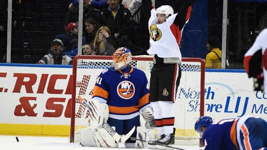 Ottawa Senators right wing Bobby Ryan (6) celebrates left wing Matt Puempel's goal as New York Islanders goalie Jaroslav Halak (41) and defenseman Thomas Hickey (14) react in the second period of an NHL hockey game on Friday, March 13, 2015, in Uniondale, N.Y. (AP Photo/Kathy Kmonicek)
