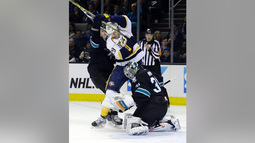 San Jose Sharks goalie Antti Niemi, bottom, stops a shot next to Nashville Predators' Paul Gaustad (28) during the second period of an NHL hockey game Thursday, March 12, 2015, in San Jose, Calif. (AP Photo/Marcio Jose Sanchez)