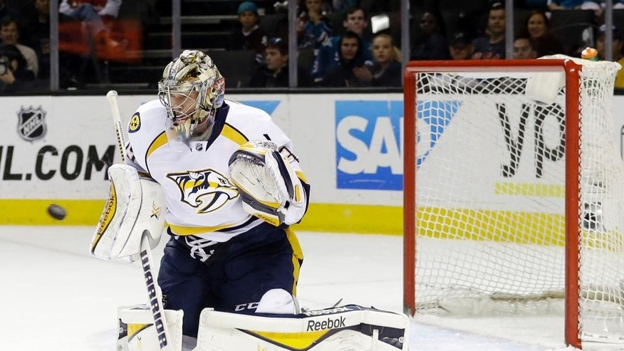 Nashville Predators goalie Pekka Rinne stops a shot against the San Jose Sharks during the first period of an NHL hockey game Thursday, March 12, 2015, in San Jose, Calif. (AP Photo/Marcio Jose Sanchez)