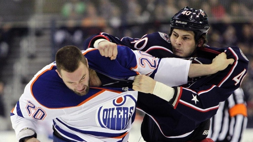 Edmonton Oilers' Luke Gazdic, left, and Columbus Blue Jackets' Jared Boll fight during the first period of an NHL hockey game Friday, March 13, 2015, in Columbus, Ohio. (AP Photo/Jay LaPrete)