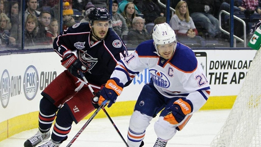 Columbus Blue Jackets' Artem Anisimov, left, of Russia, and Edmonton Oilers' Andrew Ference chase the puck during the second period of an NHL hockey game Friday, March 13, 2015, in Columbus, Ohio. (AP Photo/Jay LaPrete)