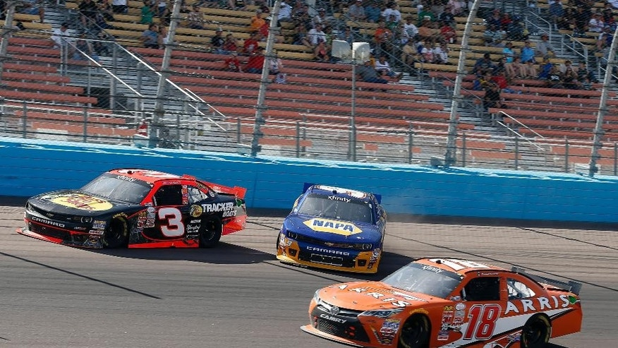 Chase Elliott (NAPA) spins between Ty Dillon (3) and Daniel Suarez in the 139th lap during the NASCAR Xfinity Series auto race on Saturday, March 14, 2015, in Avondale, Ariz.  (AP Photo/Rick Scuteri)