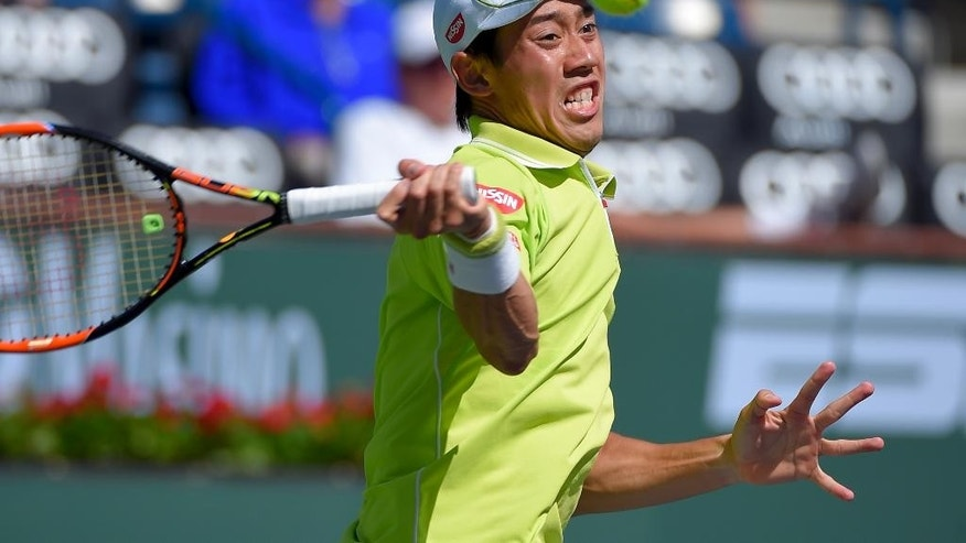 Kei Nishikori, of Japan, returns to Ryan Harrison during their match at the BNP Paribas Open tennis tournament, Saturday, March 14, 2015, in Indian Wells, Calif. (AP Photo/Mark J. Terrill)