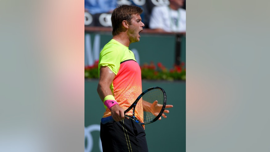 Ryan Harrison reacts after losing a point to Kei Nishikori, of Japan, during their match at the BNP Paribas Open tennis tournament, Saturday, March 14, 2015, in Indian Wells, Calif. (AP Photo/Mark J. Terrill)