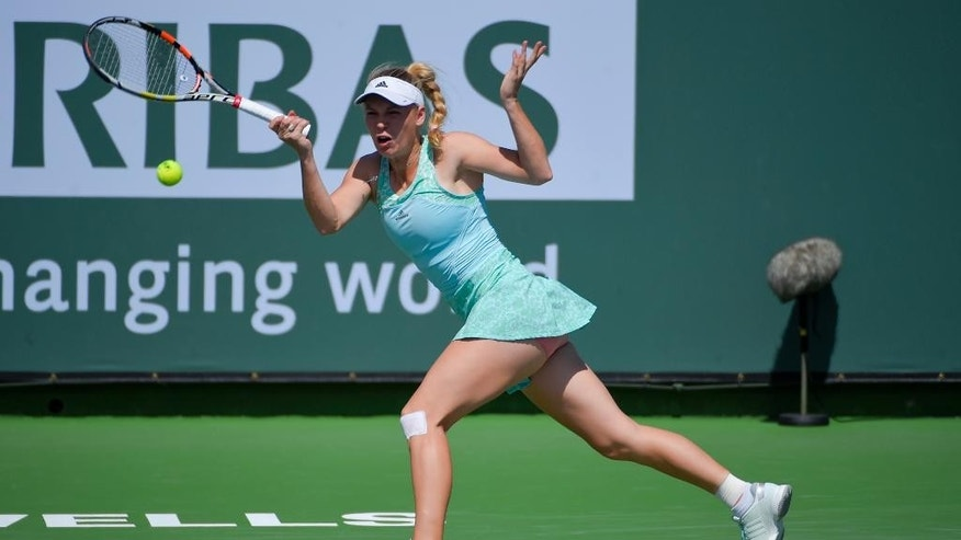 Caroline Wozniacki, of Denmark, returns to Ons Jabeur, of Tunisia, during their match at the BNP Paribas Open tennis tournament, Saturday, March 14, 2015, in Indian Wells, Calif. (AP Photo/Mark J. Terrill)