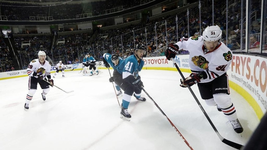 Chicago Blackhawks' Brad Richards, right, is defended by San Jose Sharks' Mirco Mueller (41) during the second period of an NHL hockey game Saturday, March 14, 2015, in San Jose, Calif. (AP Photo/Marcio Jose Sanchez)