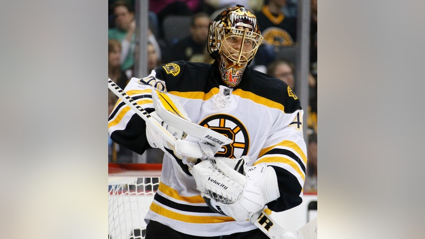 Boston Bruins goalie Tuukka Rask (40) takes a timeout during the second period of an NHL hockey game against the Pittsburgh Penguins in Pittsburgh Saturday, March 14, 2015.(AP Photo/Gene J. Puskar