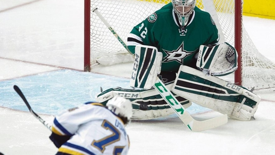 Dallas Stars goalie Kari Lehtonen (32) stops the shot from St. Louis Blues right wing T.J. Oshie (74) in the first period of an NHL hockey game, Sunday, March 15, 2015, in Dallas. (AP Photo/Tim Sharp)