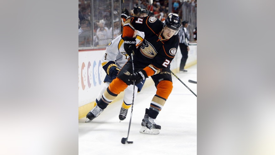 Anaheim Ducks' Simon Despres controls the puck in the first period of an NHL hockey game against the Nashville Predators in Anaheim, Calif., Sunday, March 15, 2015. (AP Photo/Christine Cotter)