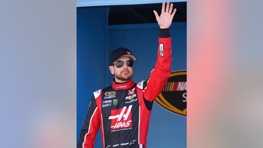 Kurt Busch waves to fans before a NASCAR Sprint Cup Series auto race on Sunday, March 15, 2015, in Avondale, Ariz.  (AP Photo/Rick Scuteri)