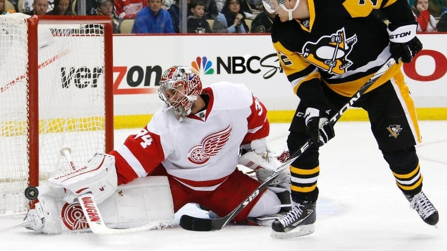 Detroit Red Wings goalie Petr Mrazek (34) blocks a shot by Pittsburgh Penguins' Patric Hornqvist (72) during the second period of an NHL hockey game against the Pittsburgh Penguins in Pittsburgh, Sunday, March 15, 2015. (AP Photo/Gene J. Puskar)