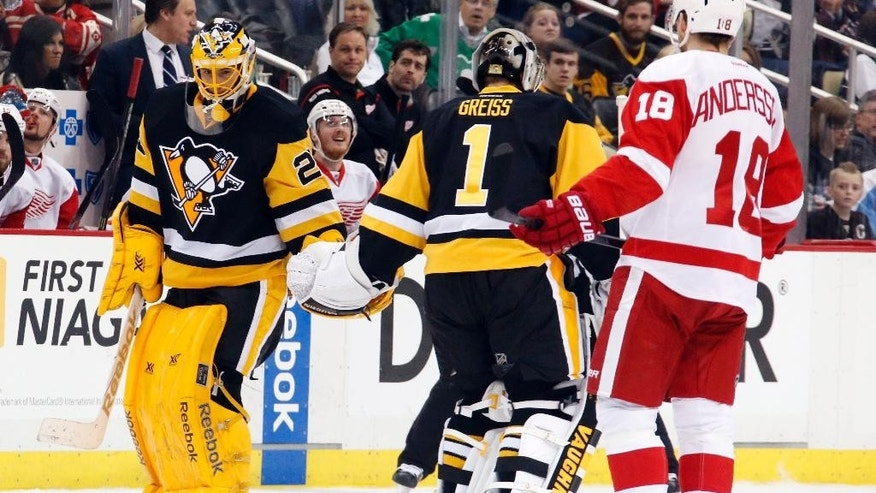 After being pulled from an NHL hockey game, Pittsburgh Penguins goalie Marc-Andre Fleury (29) skates off the ice as Thomas Greiss (1) skates on during the second period of an NHL hockey game against the Detroit Red Wings in Pittsburgh, Sunday, March 15, 2015. (AP Photo/Gene J. Puskar)