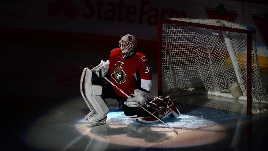 Ottawa Senators' Andrew Hammond warms up prior to taking on the Philadelphia Flyers in NHL hockey action in Ottawa, Ontario, Sunday, March 15, 2015. (AP Photo/The Canadian Press, Sean Kilpatrick)