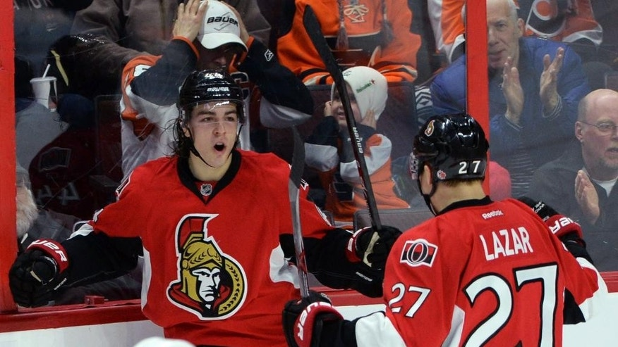 Ottawa Senators' Jean-Gabriel Pageau and Curtis Lazar (27) celebrate a second period goal against the the Philadelphia Flyers during NHL hockey action in Ottawa, Ontario, Sunday, March 15, 2015. (AP Photo/The Canadian Press, Sean Kilpatrick)