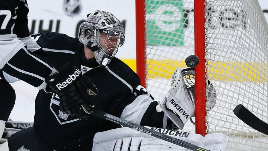 Los Angeles Kings goalie Jonathan Quick makes a save against the Nashville Predators during the first period of an NHL hockey game Saturday, March 14, 2015, in Los Angeles. (AP Photo/Danny Moloshok)