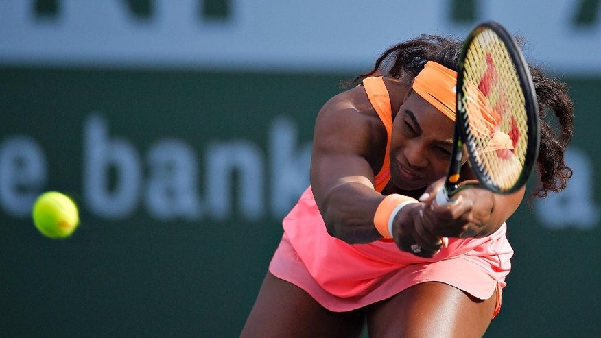 Serena Williams returns to Zarina Diyas, of Kazakhstan, during their match at the BNP Paribas Open tennis tournament, Sunday, March 15, 2015, in Indian Wells, Calif. (AP Photo/Mark J. Terrill)