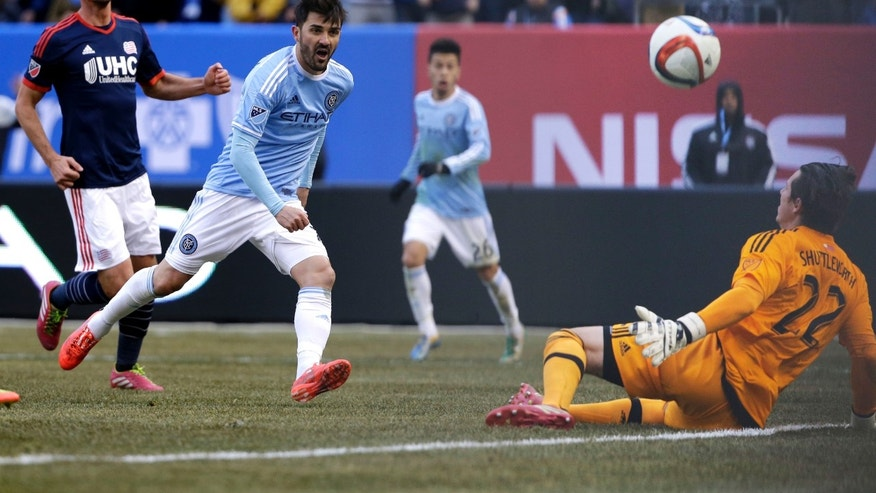 New York City FC's David Villa, second from left, scores past New England Revolution goalkeeper Bobby Shuttleworth, right, during the first half of an MLS soccer game at Yankee Stadium in New York, Sunday, March 15, 2015. (AP Photo/Seth Wenig)