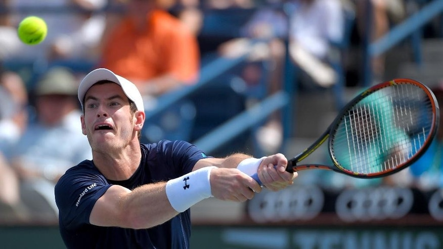 Andy Murray, of Great Britain, returns a volley from Philipp Kohlschreiber, of Germany, during their match at the BNP Paribas Open tennis tournament, Monday, March 16, 2015 in Indian Wells, Calif. (AP Photo/Mark J. Terrill)