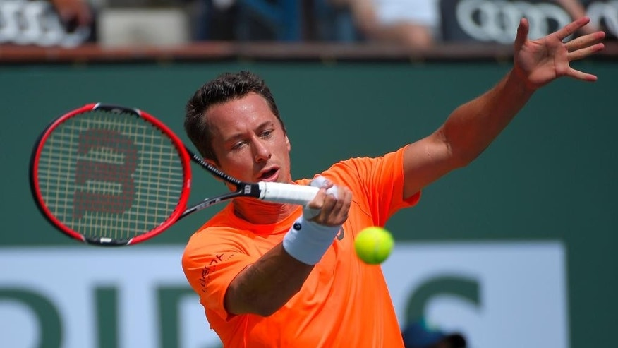 Philipp Kohlschreiber, of Germany, returns a volley from Andy Murray, of Great Britain, during their match at the BNP Paribas Open tennis tournament, Monday, March 16, 2015 in Indian Wells, Calif. (AP Photo/Mark J. Terrill)