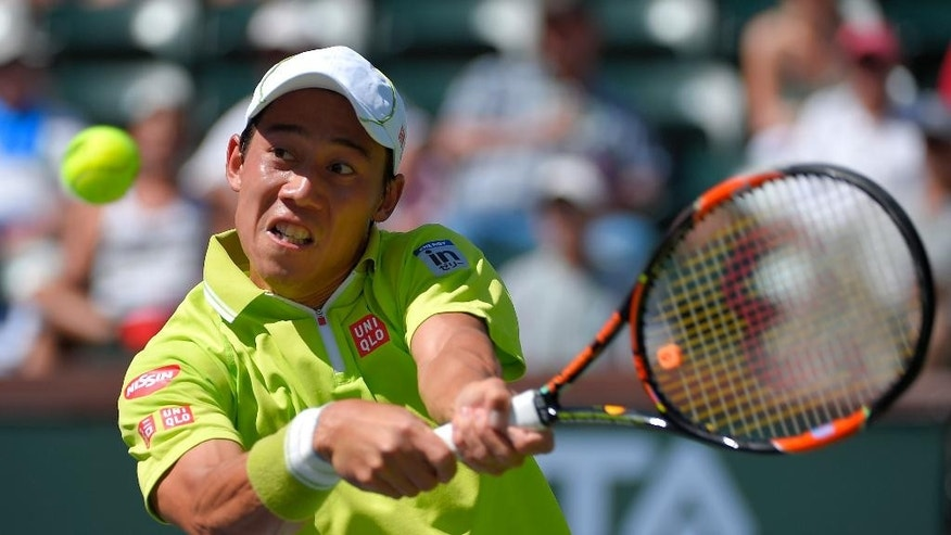 Kei Nishikori, of Japan, returns a volley from Fernando Verdasco, of Spain, during their match at the BNP Paribas Open tennis tournament, Monday, March 16, 2015 in Indian Wells, Calif. (AP Photo/Mark J. Terrill)