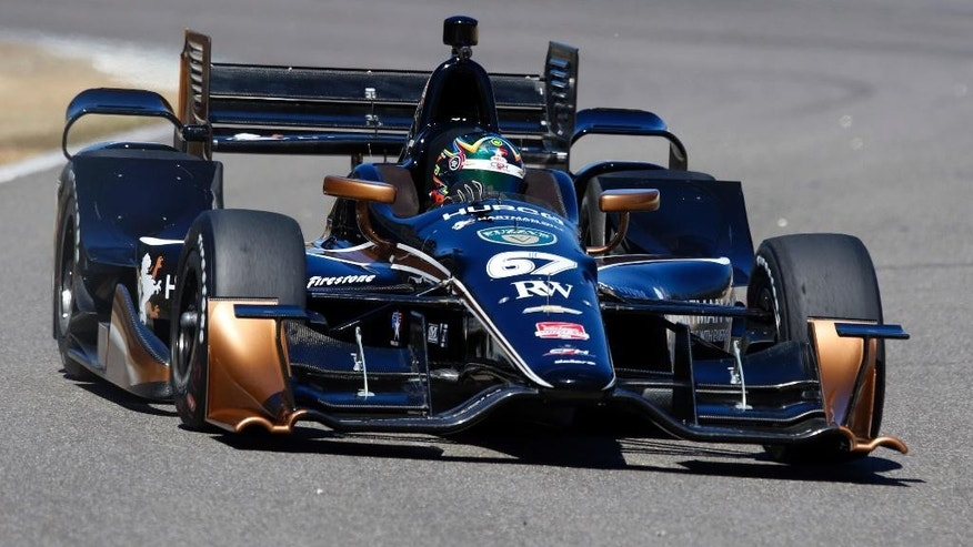 Josef Newgarden (67) heads into a turn during IndyCar auto racing testing at Barber Motorsports Park, Monday, March 16, 2015, in Birmingham, Ala. Drivers are testing the new aerodynamic packages on their cars. (AP Photo/Butch Dill)