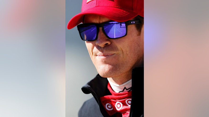 Scott Dixon, of New Zealand, looks down pit lane during IndyCar testing at Barber Motorsports Park, Monday, March 16, 2015, in Birmingham, Ala. Drivers are testing the new aerodynamic packages on their cars. (AP Photo/Butch Dill)