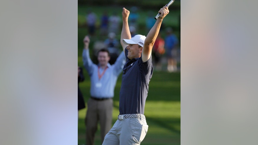 Jordan Spieth reacts after winning Valspar Championship golf tournament on the third playoff hole Sunday, March 15, 2015, at Innisbrook in Palm Harbor, Fla. (AP Photo/Chris O'Meara)