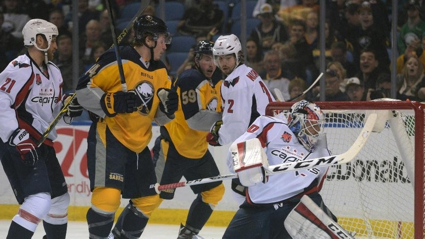 Washington Capitals' Brooks Laich (21) and Matt Niskanen (2) contain Buffalo Sabres' Nicolas Deslauriers (44) and Tim Schaller (59) as Capitals goaltender Braden Holtby (70) watches the puck get behind him for a goal by Sabres' Cody Hodgson during the first period of an NHL hockey game Monday, March 16, 2015, in Buffalo, N.Y. (AP Photo/Gary Wiepert)