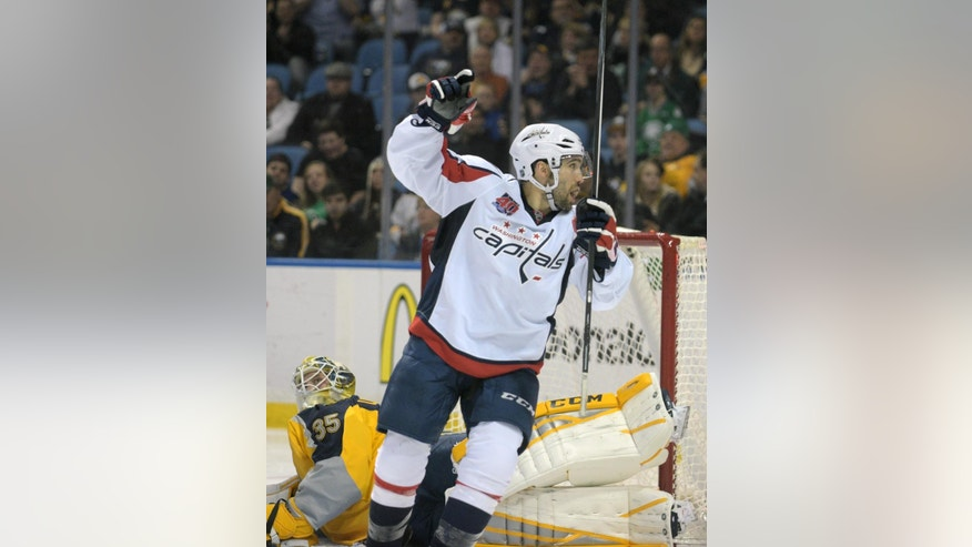 Buffalo Sabres goaltender Anders Lindback (35), of Sweden, reacts to a goal by Washington Capitals Mike Green as Capitals' Chris Conner, right, celebrates during the second period of an NHL hockey game Monday, March 16, 2015, in Buffalo, N.Y. (AP Photo/Gary Wiepert)