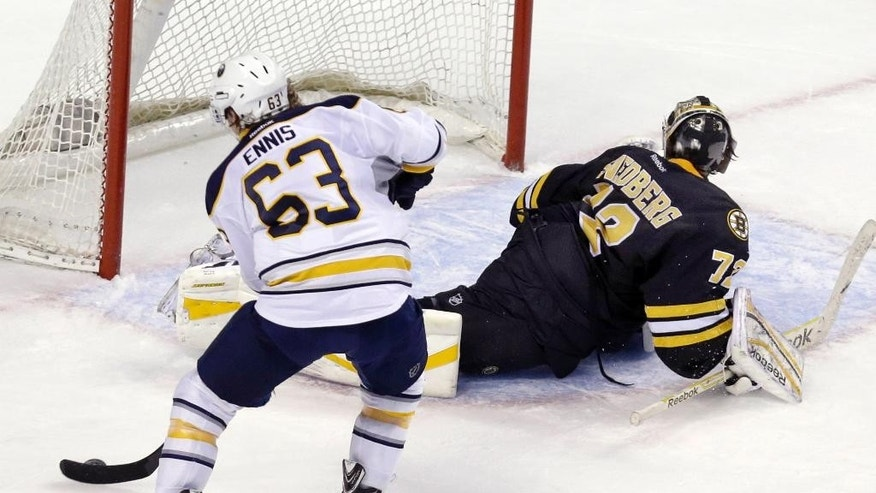 Buffalo Sabres left wing Tyler Ennis (63) has Boston Bruins goalie Niklas Svedberg (72) faked out and turned away as he is able to score during the shootout of an NHL hockey game in Boston, Tuesday, March 17, 2015. The Sabres won 2-1. (AP Photo/Elise Amendola)