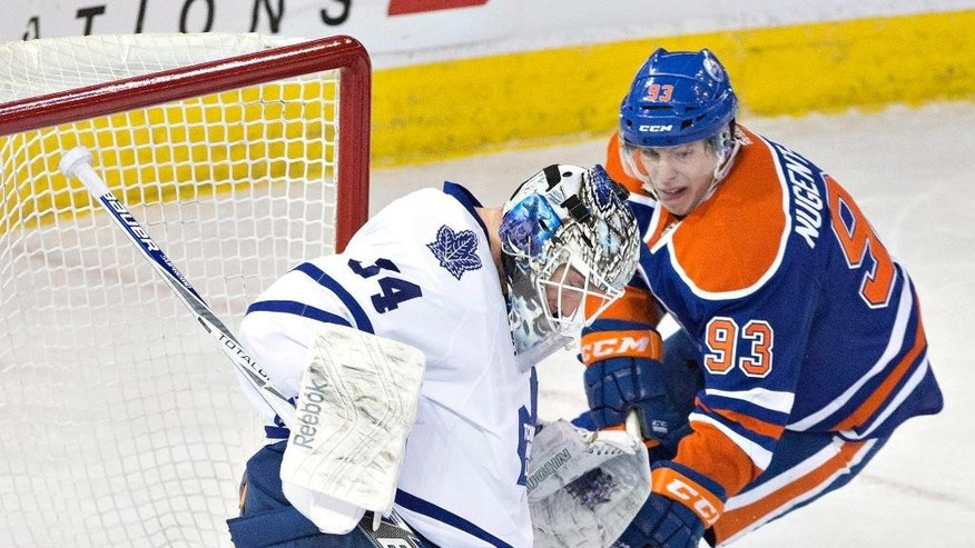 Toronto Maple Leafs goalie James Reimer (34) makes a save on Edmonton Oilers' Ryan Nugent-Hopkins (93) during the first period of an NHL hockey game in Edmonton, Alberta, Monday, March 16, 2015. (AP Photo/The Canadian Press, Jason Franson)