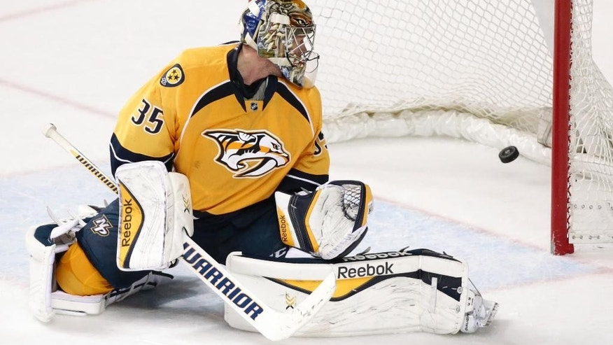 Nashville Predators goalie Pekka Rinne, of Finland, watches as a shot by Minnesota Wild defenseman Matt Dumba gets past for the winning goal in overtime at an NHL hockey game Tuesday, March 17, 2015, in Nashville, Tenn. The Wild won 3-2. (AP Photo/Mark Humphrey)