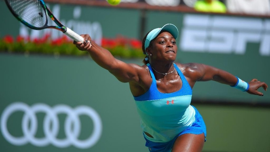 Sloane Stephens returns a volley from  Serena Williams during their match at the BNP Paribas Open tennis tournament, Tuesday, March 17, 2015 in Indian Wells, Calif. (AP Photo/Mark J. Terrill)