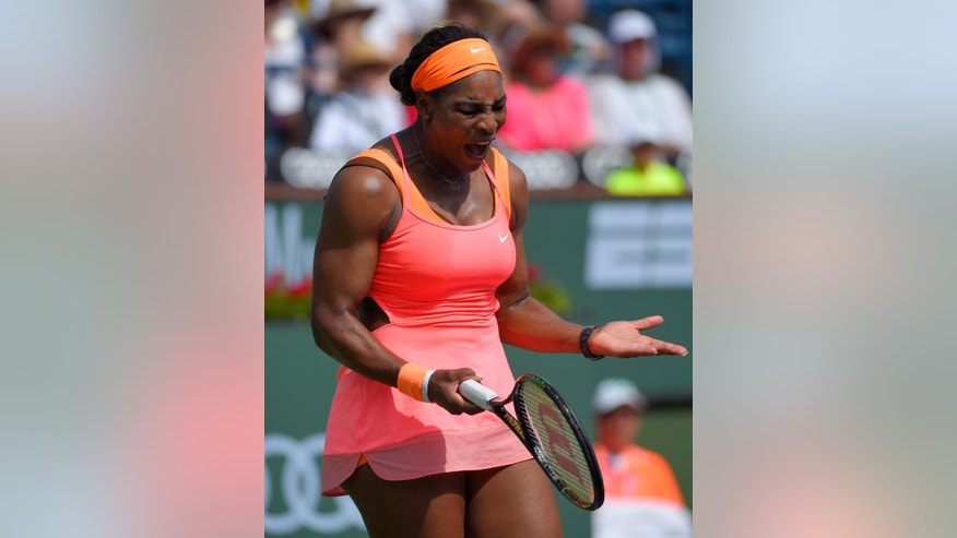 Serena Williams reacts to losing a point to Sloane Stephens during their match at the BNP Paribas Open tennis tournament, Tuesday, March 17, 2015 in Indian Wells, Calif. (AP Photo/Mark J. Terrill)