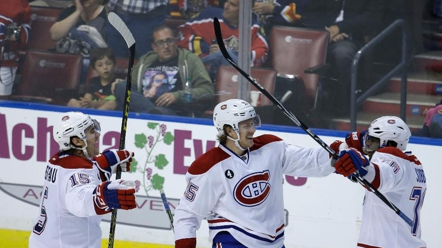 Montreal Canadiens defenseman P.K. Subban, right, celebrates with P.A. Parenteau (15) and Jacob De La Rose (25) after scoring a goal against the Florida Panthers during the second period of an NHL hockey game, Tuesday, March 17, 2015,  in Sunrise, Fla. (AP Photo/Lynne Sladky)