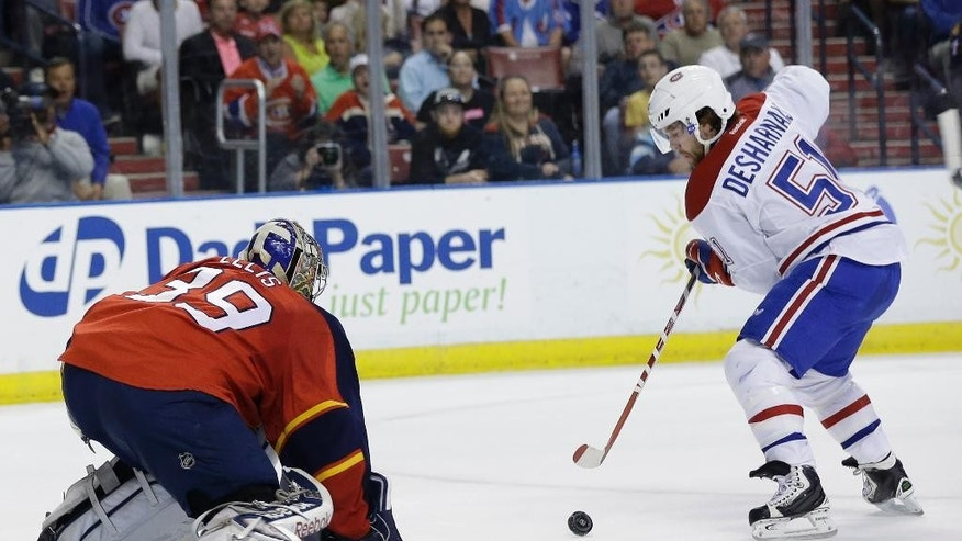 Montreal Canadiens center David Desharnais (51) attempts a shot on the goal which was deflected by Florida Panthers goalie Dan Ellis (39) during the first period of an NHL hockey game, Tuesday, March 17, 2015,  in Sunrise, Fla. (AP Photo/Lynne Sladky)