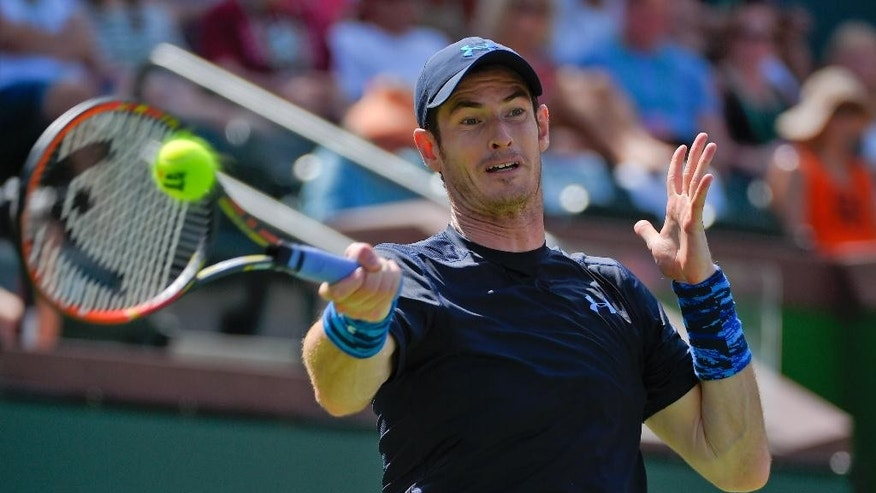 Andy Murray, of Great Britain, returns to Adrian Mannarino, of France, during their match at the BNP Paribas Open tennis tournament, Wednesday, March 18, 2015, in Indian Wells, Calif. (AP Photo/Mark J. Terrill)