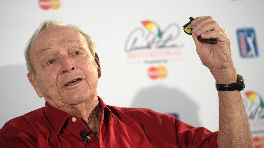 Arnold Palmer answers a question from a reporter at a news conference during the pro-am for the Arnold Palmer Invitational golf tournament in Orlando, Fla., Wednesday, March 18, 2015.(AP Photo/Phelan M. Ebenhack)