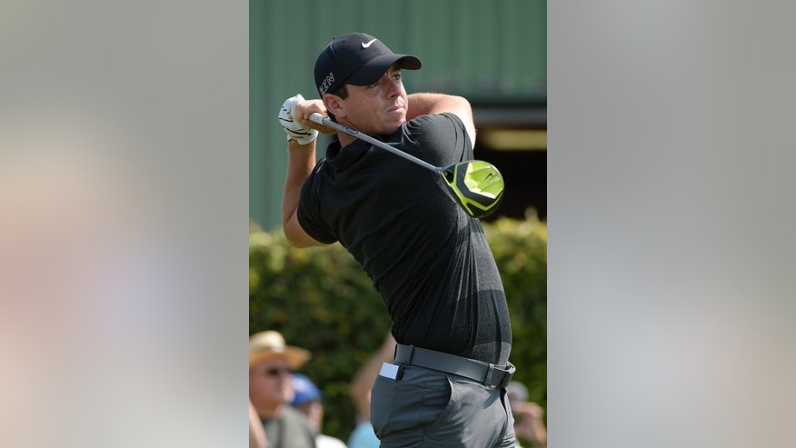 Rory McIlroy, of Northern Ireland, watches his tee shot on the ninth hole during a pro-am for the Arnold Palmer Invitational golf tournament in Orlando, Fla., Wednesday, March 18, 2015.(AP Photo/Phelan M. Ebenhack)