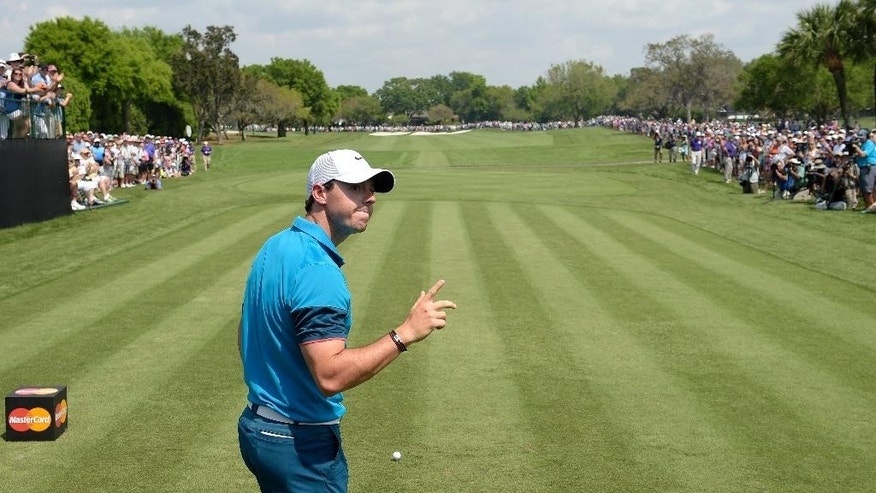 Rory McIlroy, of Northern Ireland, acknowledges the gallery before teeing off on the first hole in first round of the Arnold Palmer Invitational golf tournament in Orlando, Fla., Thursday, March 19, 2015.(AP Photo/Phelan M. Ebenhack)