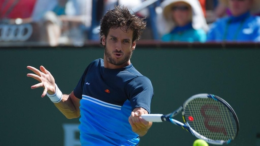 Feliciano Lopez, of Spain, returns a shot to Andy Murray, of Great Britain, during their match at the BNP Paribas Open tennis tournament, Thursday, March 19, 2015, in Indian Wells, Calif. (AP Photo/Mark J. Terrill)