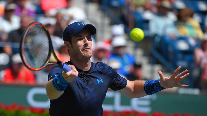 Andy Murray, of Great Britain, returns a shot to Feliciano Lopez, of Spain, during their match at the BNP Paribas Open tennis tournament, Thursday, March 19, 2015, in Indian Wells, Calif. (AP Photo/Mark J. Terrill)