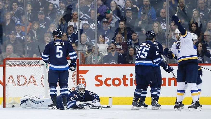 St. Louis Blues' David Backes, right, celebrates after scoring against Winnipeg Jets goaltender Ondrej Pavelec (31) during the second period of an NHL hockey game Thursday, March 19, 2015, in Winnipeg, Manitoba. (AP Photo/The Canadian Press, John Woods)