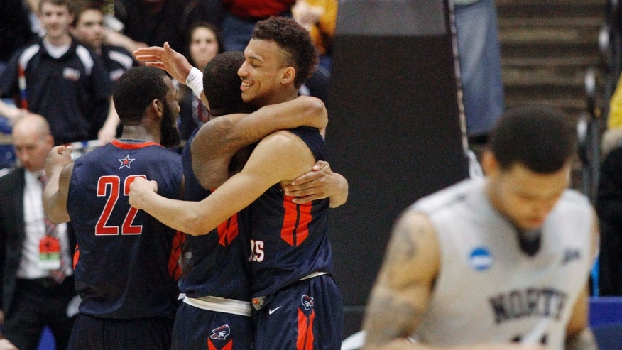 March 18, 2015: Robert Morris players celebrate after an 81-77 win over North Florida in a first round NCAA tournament basketball game.