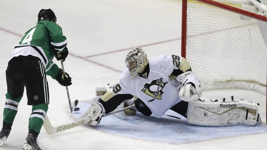 Dallas Stars left wing Jamie Benn (14) beats Pittsburgh Penguins goalie Marc-Andre Fleury (29) on his way to scoring a goal during the second period of an NHL hockey game Thursday, March 19, 2015, in Dallas. (AP Photo/LM Otero)