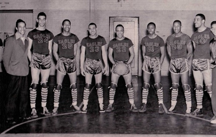 "The Durham News & Observer identified the players for the Eagles from the left as Coach John B. McLendon, George Parks, an unidentified player, Billy Williams, James Hardy, Aubrey 'Stinkey' Stanley, Floyd Brown, Henry 'Big Dog' Thomas and manager Edward ""Pee Wee"" Boyd."